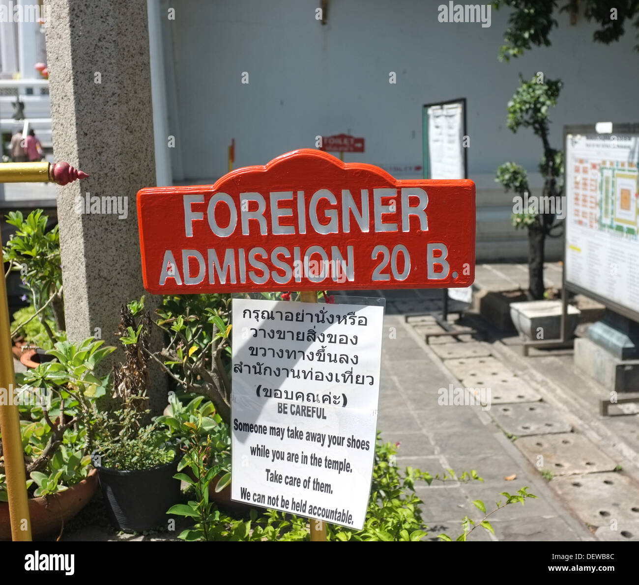 'Foreigner Admission' fee sign at Bangkok temple. - Stock Image