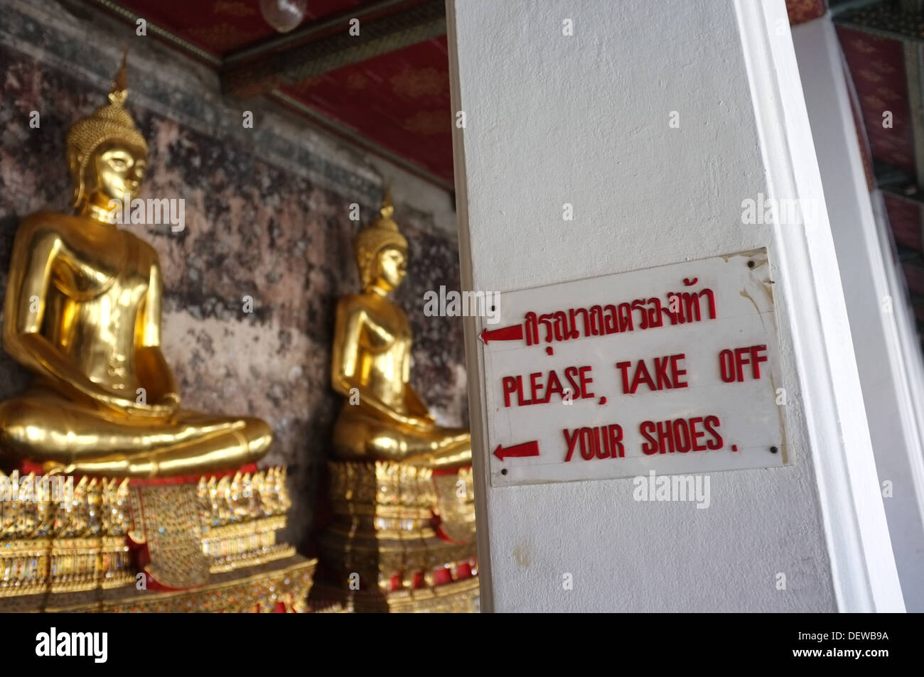"""Please take off your shoes"" sign at Buddhist temple in Bangkok, Thailand Stock Photo"
