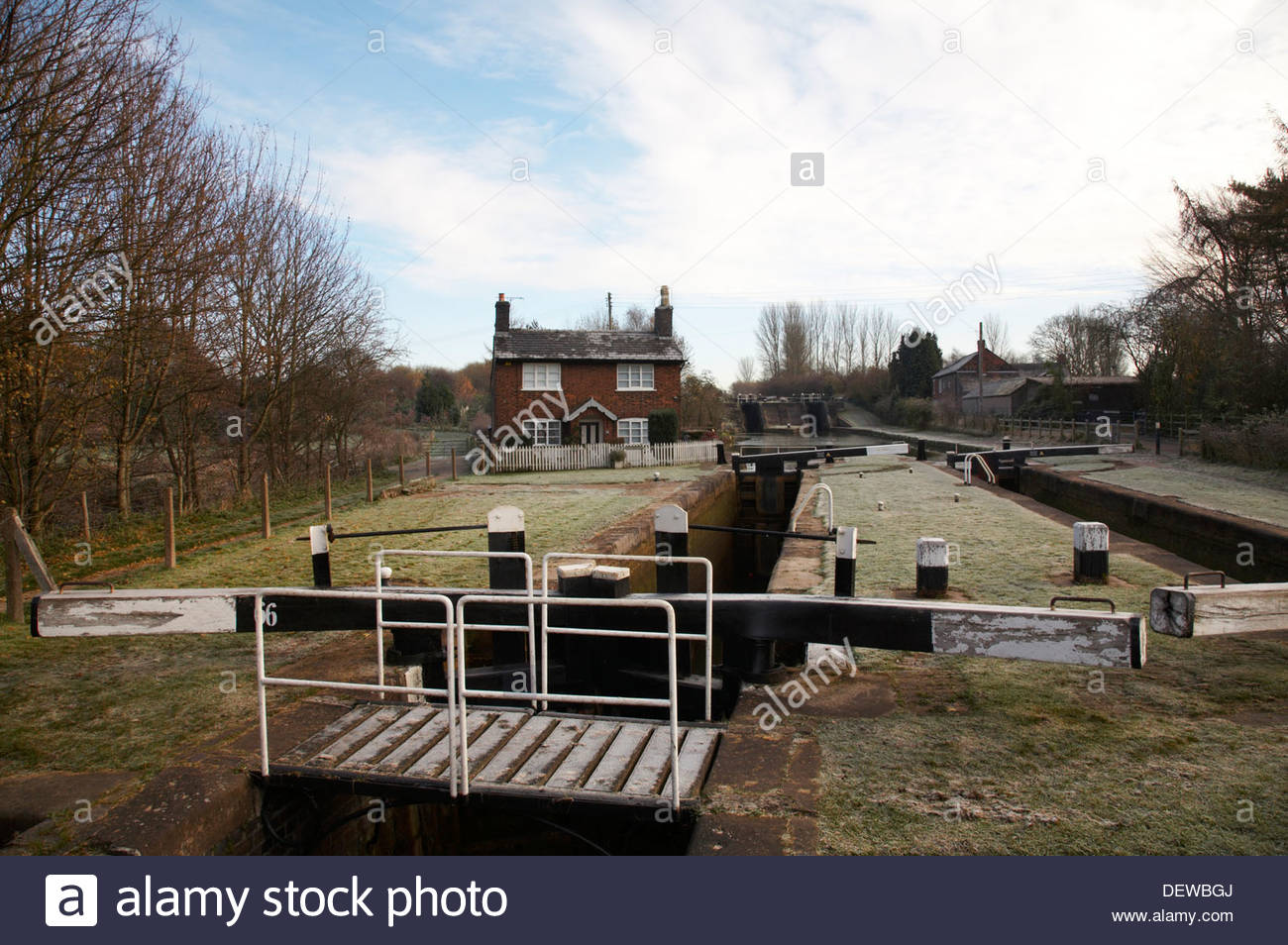 Lock keepers cottage in winter with locks in Wheelock, Cheshire, UK - Stock Image