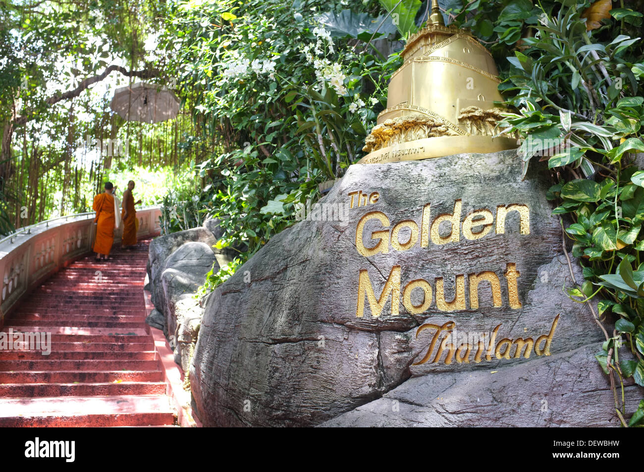 Two Buddhist monks climb the steps to the Golden Mount (Wat Saket), Bangkok Thailand Stock Photo