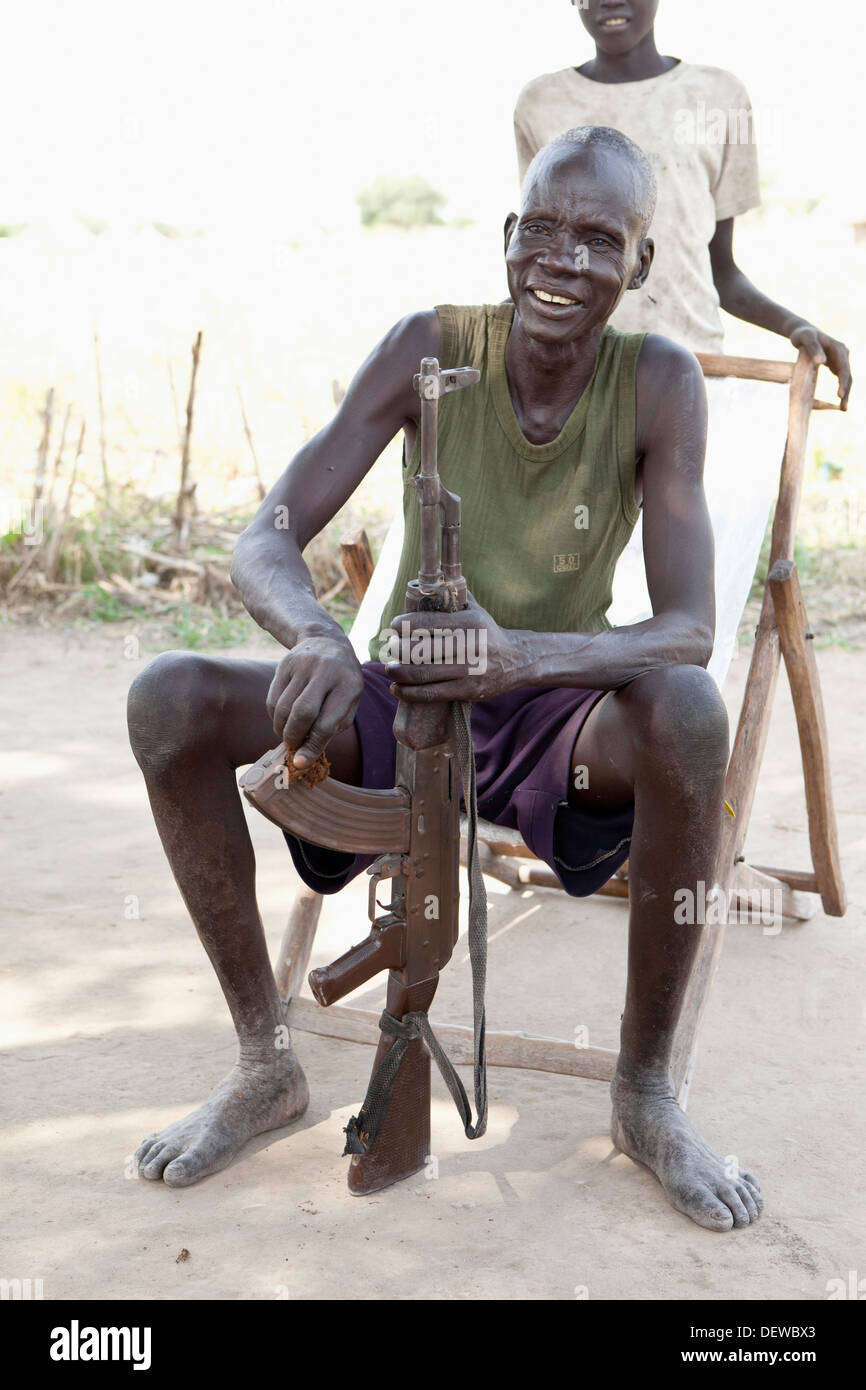 Dinka man cleaning ak-47 in Lilir Sudan, December 2010 - Stock Image