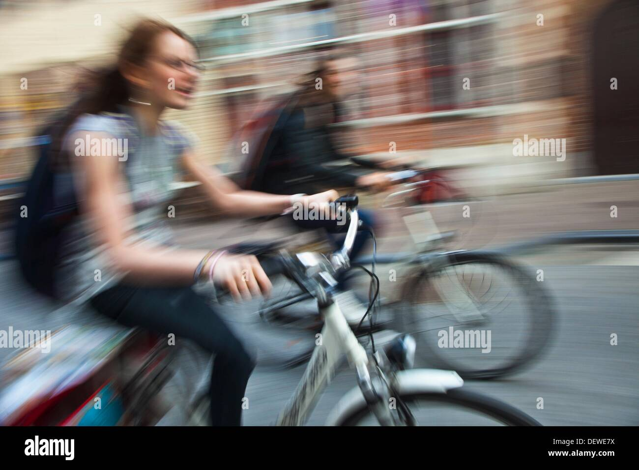 People in cycle  Bruges, Brugge, Flanders,Belgium, UNESCO World Heritage Site. - Stock Image