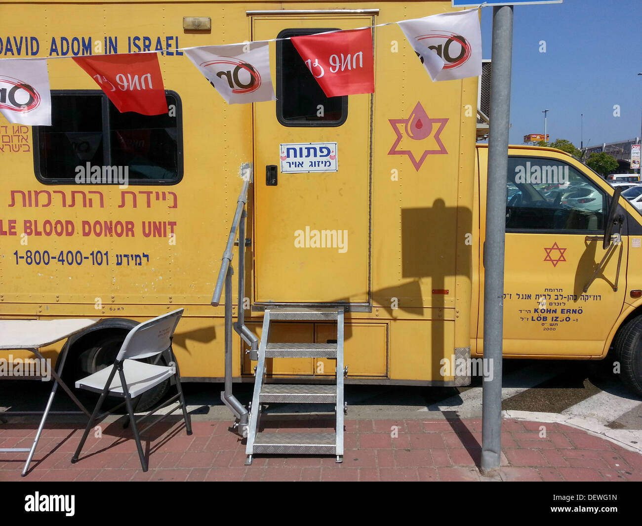Blood donations are collected in a blood mobile ambulance - Stock Image
