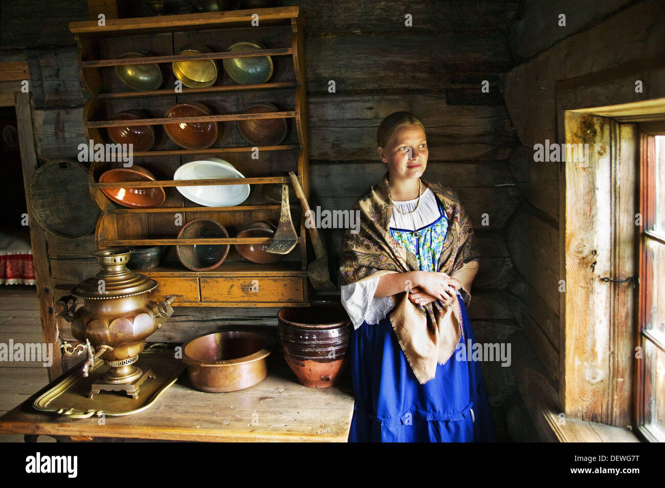 Replica of a Russian traditional house with a samovar on the table, museum of Russian wooden architecture of Kizhi, Lake Onega, - Stock Image