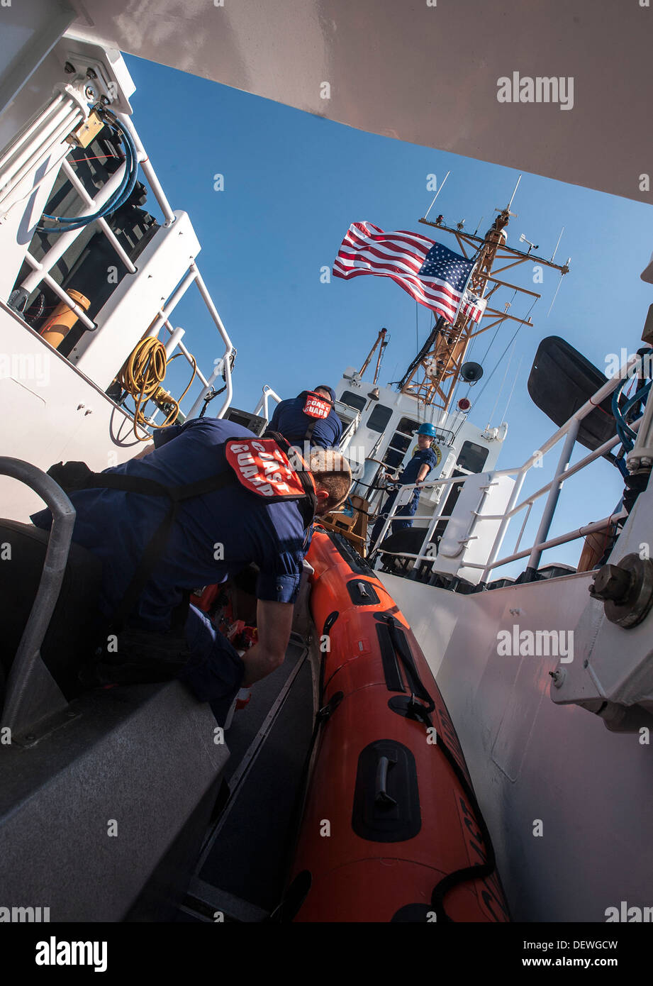 SAN PEDRO, Calif. - The crew of the Coast Guard Cutter Narwhal prepares to launch a small boat while patrolling the Port of Los - Stock Image