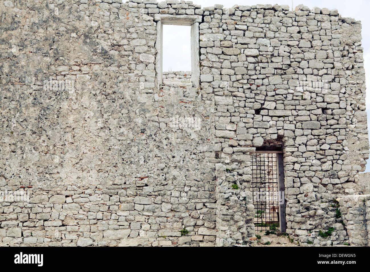 Old stone wall belonging to the ancient Venetian monastery in Osor, Cres island, Croatia - Stock Image
