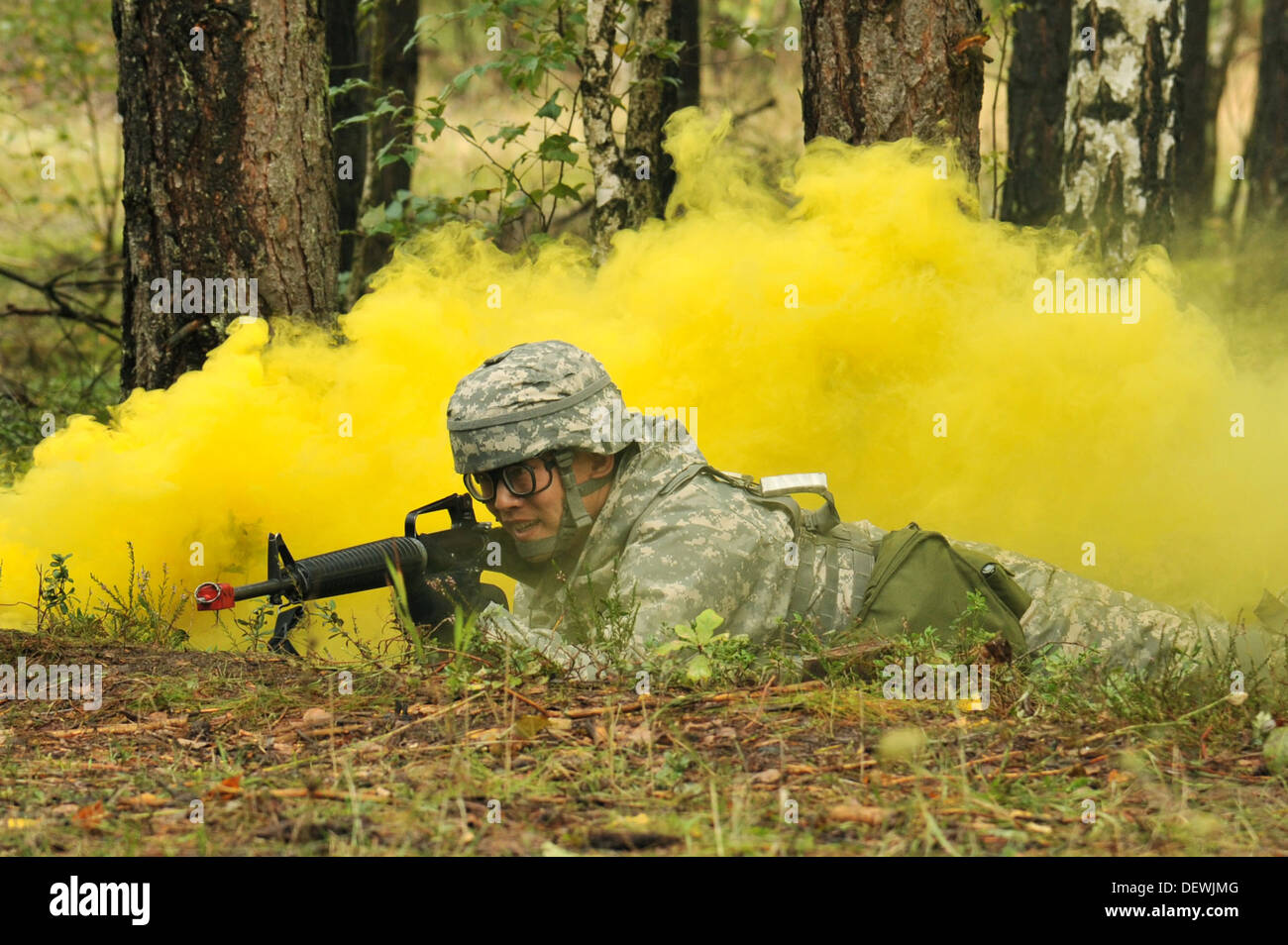 U.S. Army 2nd Lt. Chunjiang Liao utilizes smoke for concealment before crossing a road during the U.S. Army Europe Expert Field - Stock Image
