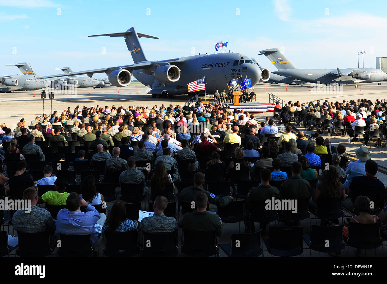 The audience listens to the guest speakers, during a delivery ceremony Sept. 12, 2013, on the flight line at JB Charleston - Air Base, S.C. JB Charleston received the last U.S. Air Force C-17 Globemaster III, P-223 This historical event comes more than 20 - Stock Image