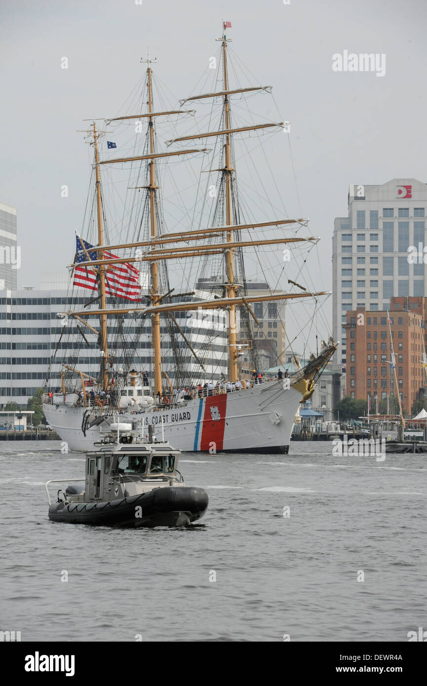 The Coast Guard Cutter Eagle is shown being escorted by a Norfolk Police boat while transisting the Elizabeth River toward downtown Portsmouth, Va., Friday, Sept. 13, 2013. - Stock Image