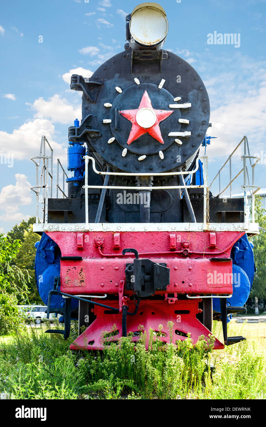 The ancient steam locomotive stands on a pedestal Stock Photo