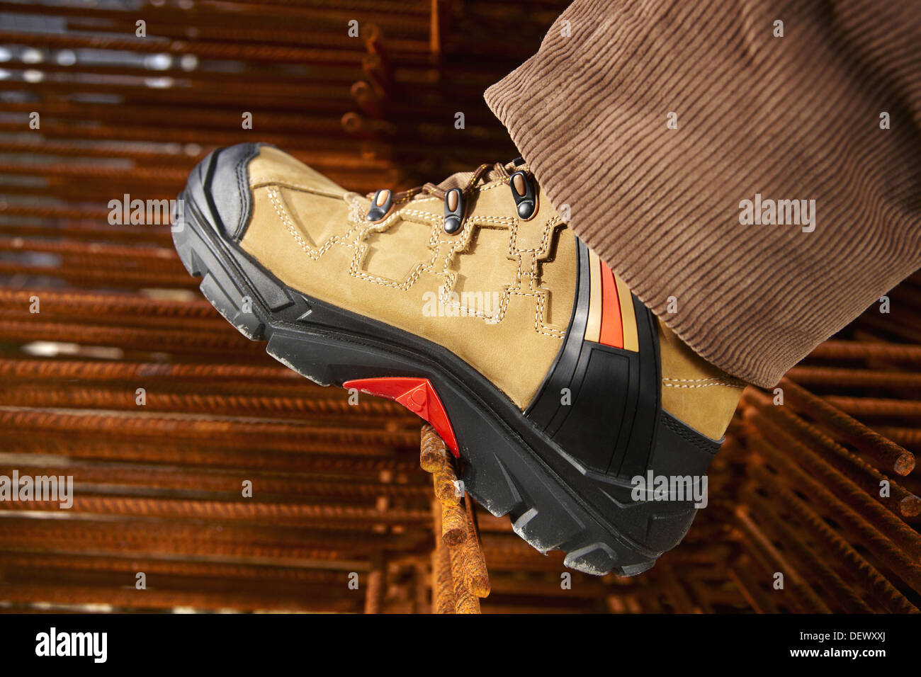 Safety boot, corrugated iron for formwork, housing construction - Stock Image