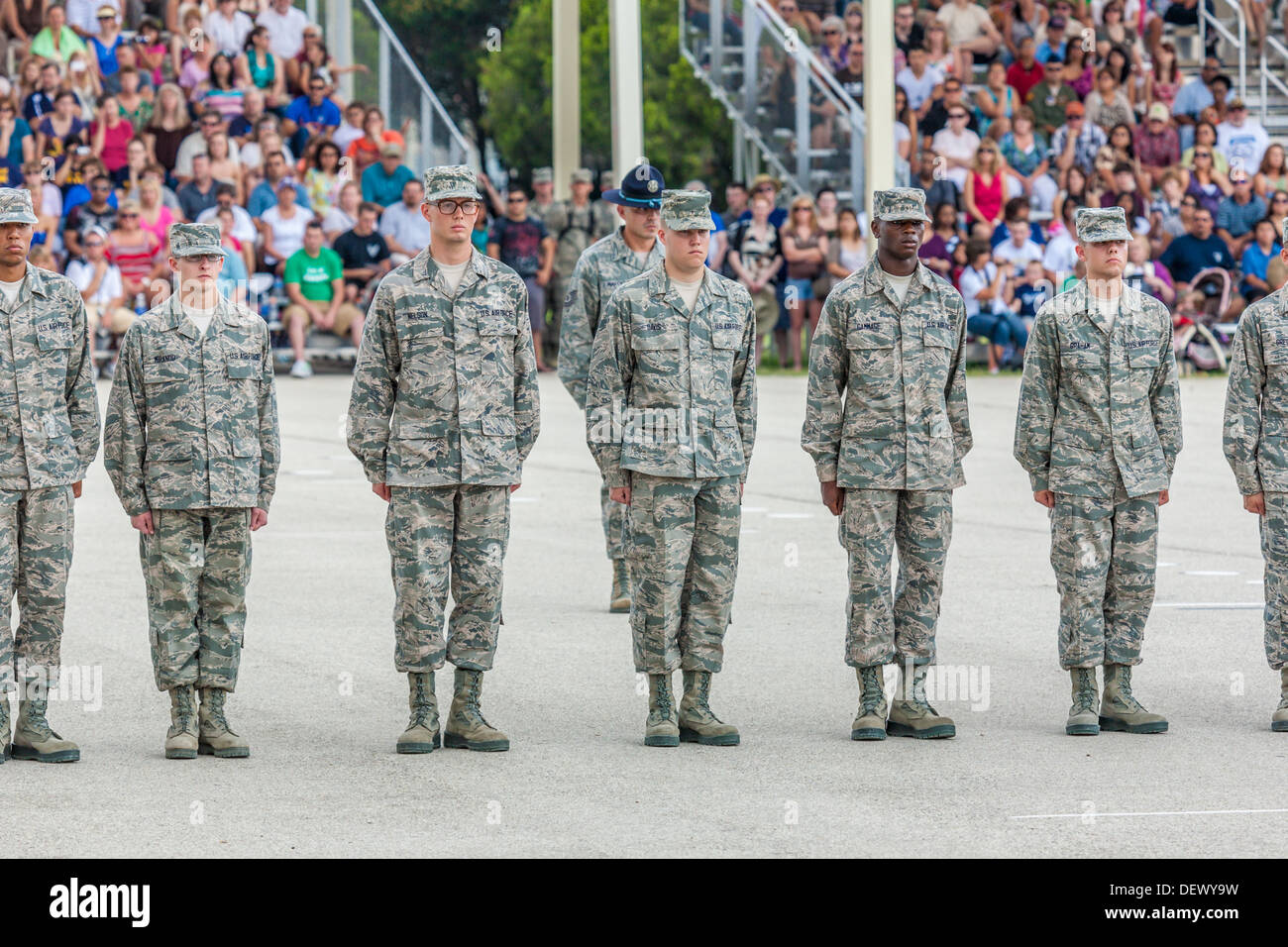 Airmen standing at attention during United States Air Force basic training graduation ceremonies In San Antonio, Texas - Stock Image