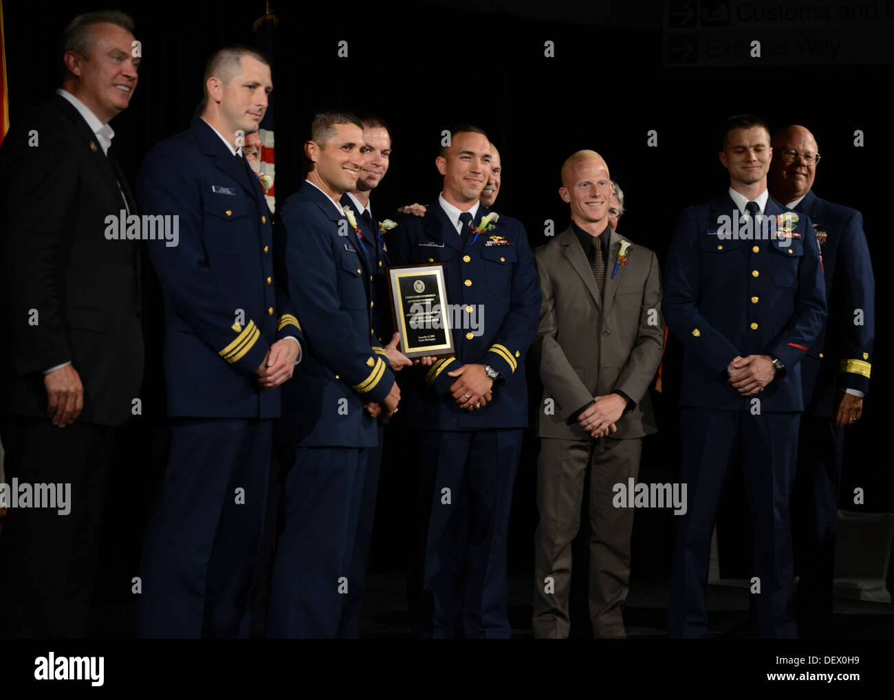 (From left to right) Lt. Cmdr. Nathan Coulter, Lt. Benjamin Berman, Petty Officer 2nd Class James Rizer, Lt. Leo Lake, Petty Off - Stock Image