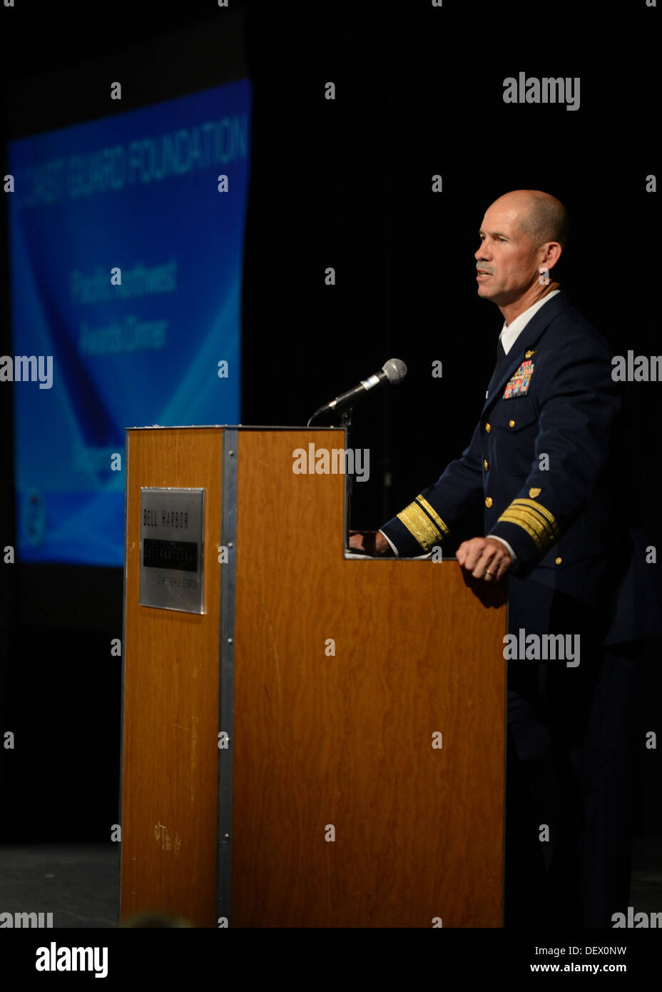 Rear Adm. Charles Ray, deputy commander of Coast Guard Pacific Area, delivers remarks at the Coast Guard Foundation's Pacific Northwest Awards Dinner at the Bell Harbor International Conference Center in Seattle, Sep. 12, 2013. The Coast Guard Foundation - Stock Image