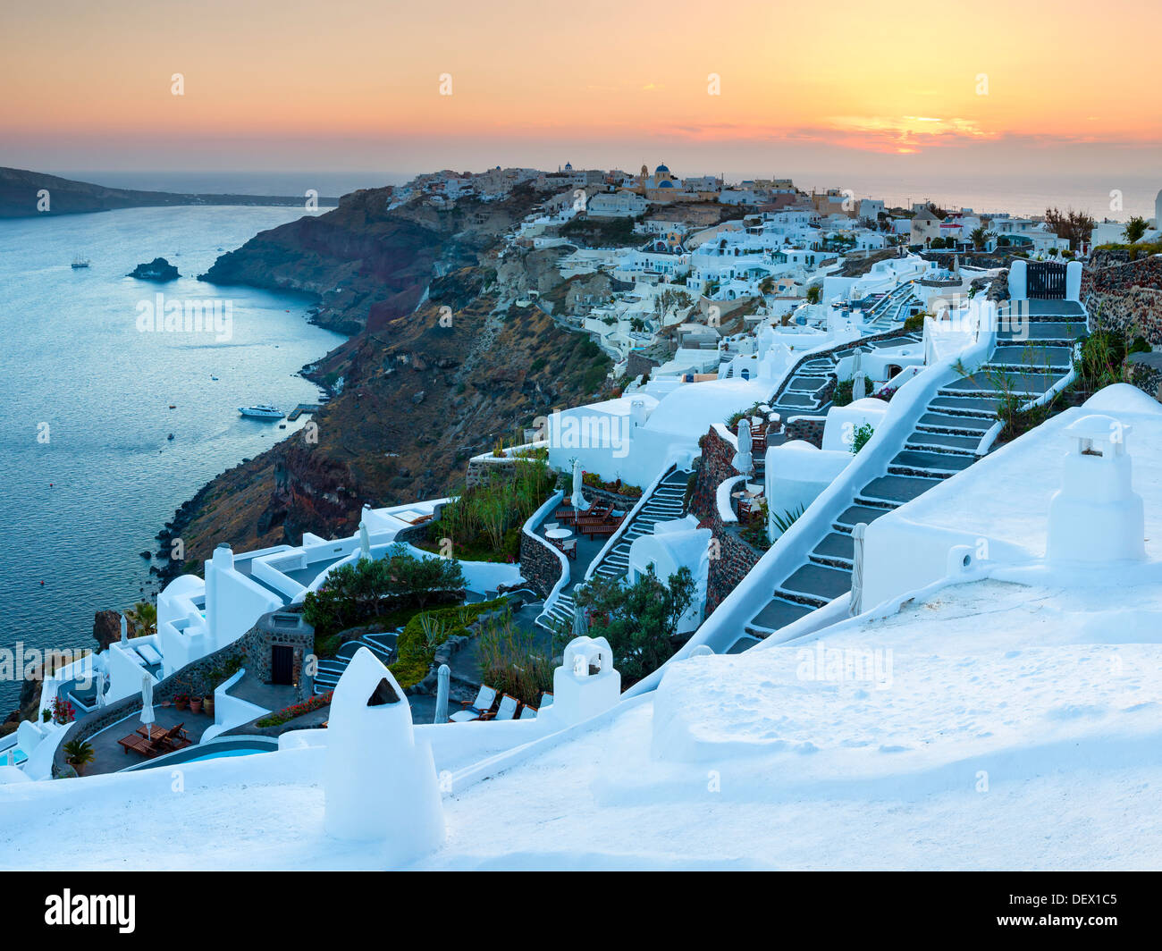 Sunset over the village of Oia on the Island of Santorini Greece Europe - Stock Image