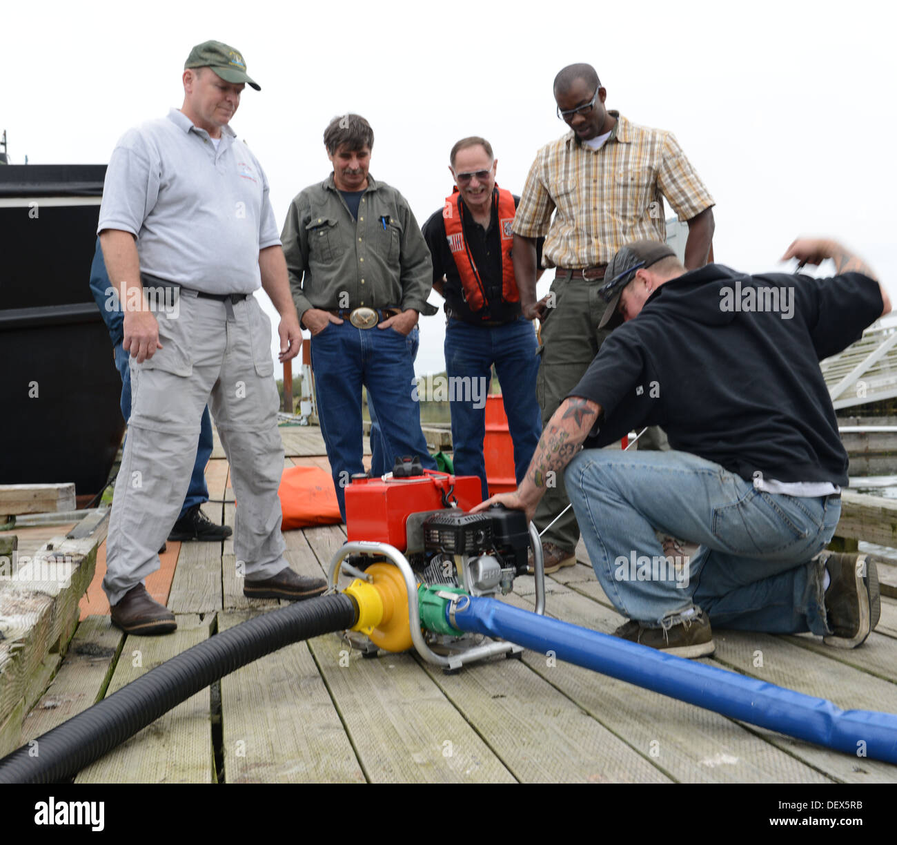 Curt Farrell (left), course instructor and commercial fishing vessel safety coordinator for Coast Guard Marine Safety Unit Portl - Stock Image