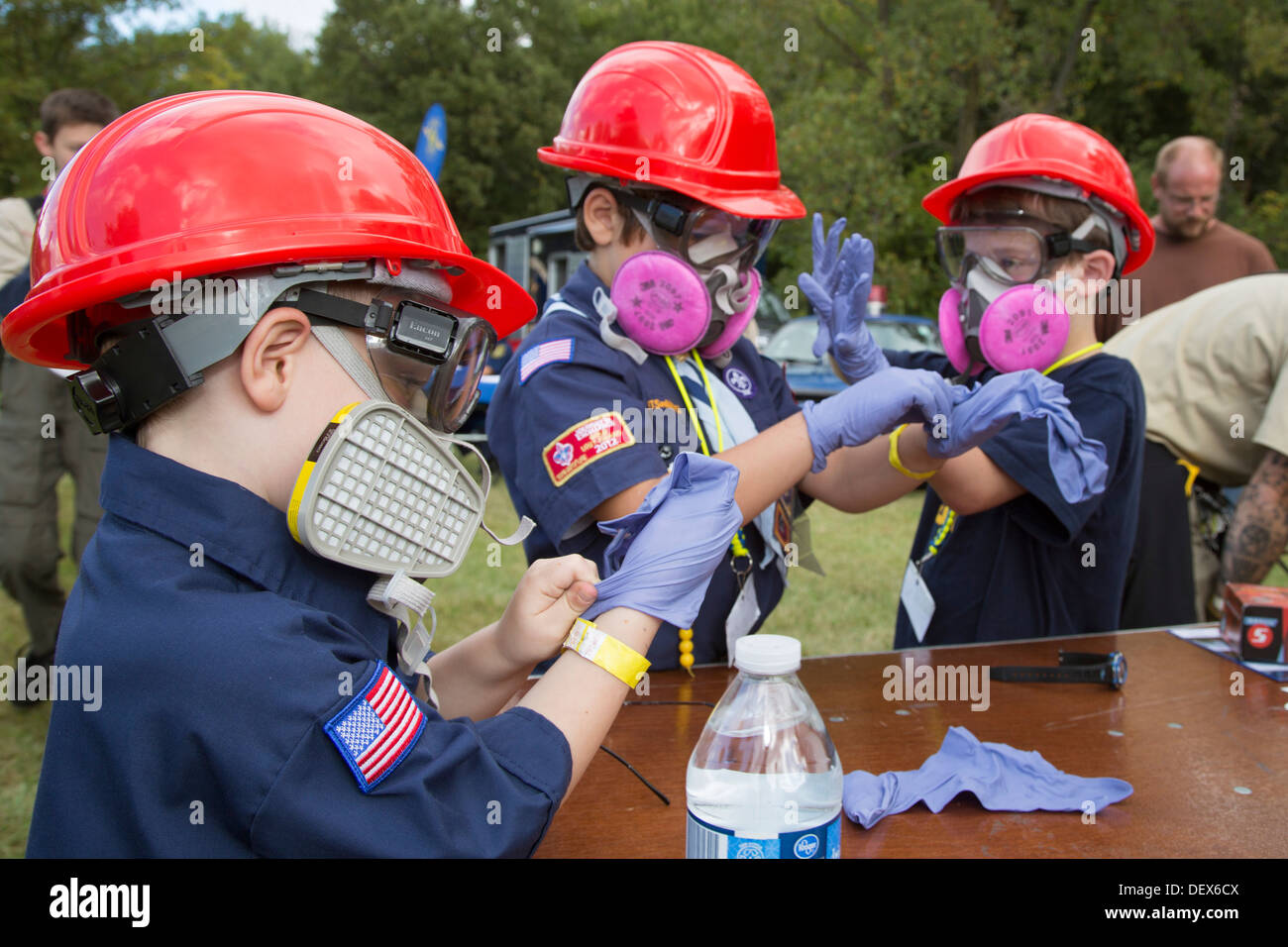 Cub Scouts try on crime-scene evidence gathering gear used by the Michigan State Police at a Scout gathering. - Stock Image