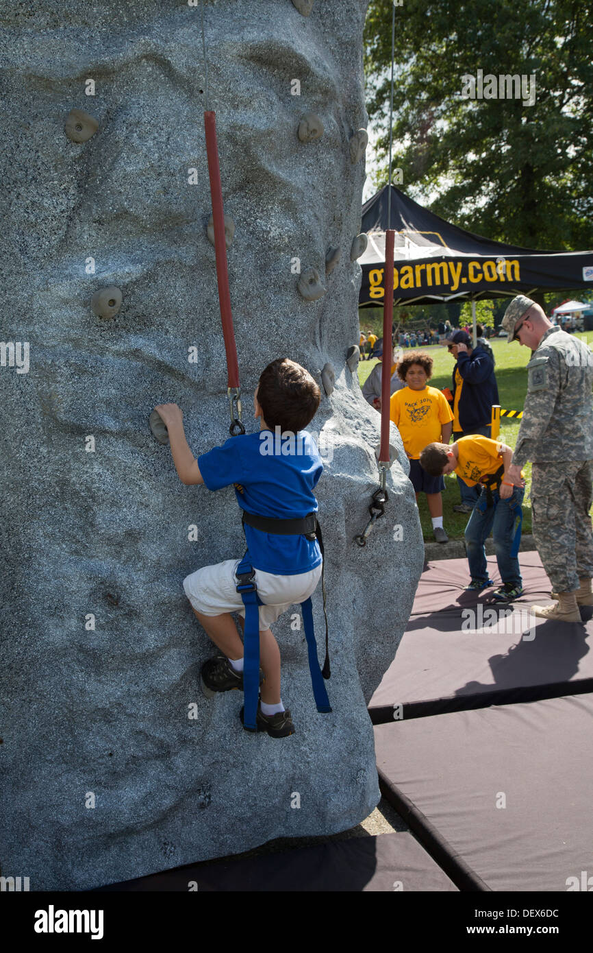 New Boston, Michigan - A Boy Scout on a climbing wall at an Army booth during a Scout gathering at a suburban Detroit park. - Stock Image