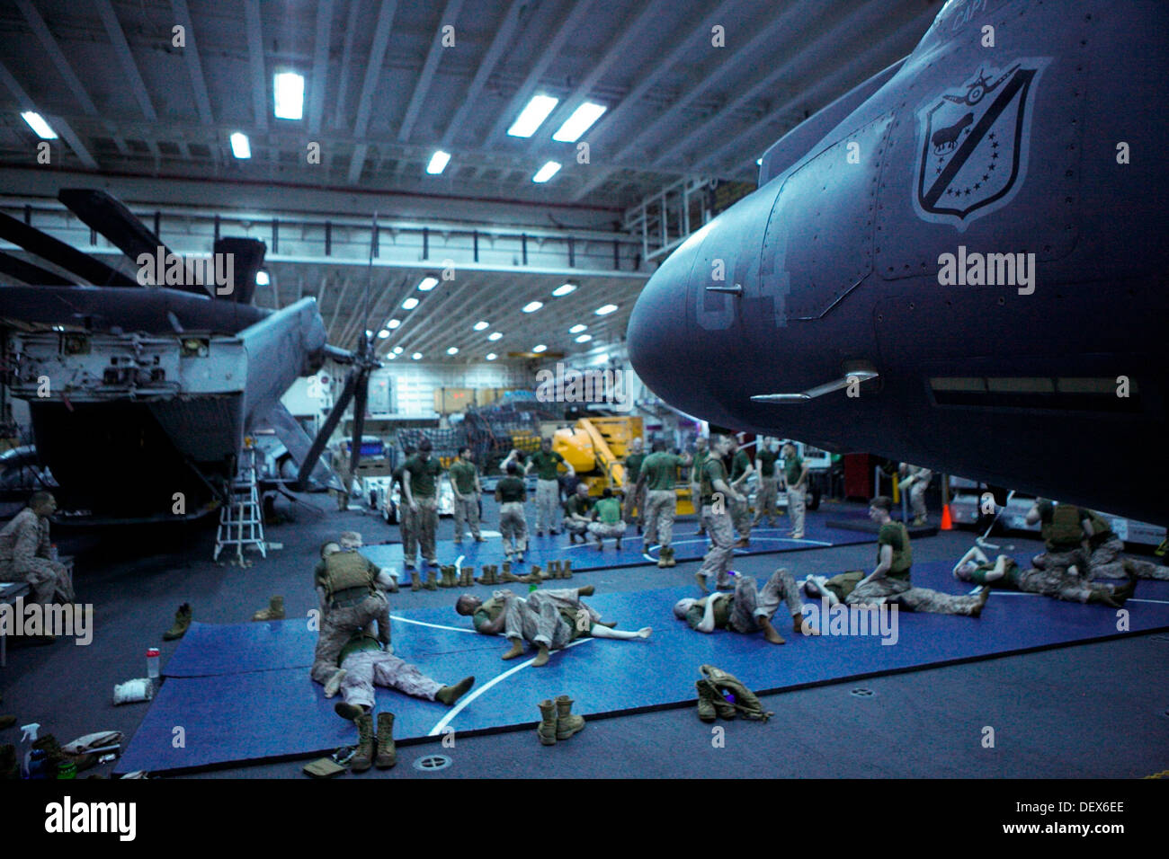 Marines and Sailors with the 31st Marine Expeditionary Unit conduct Marine Corps Martial Arts training in the hanger bay here, Sept. 12. Those participating in the MCMAP training have to work around the challenges that being deployed on an amphibious wars - Stock Image