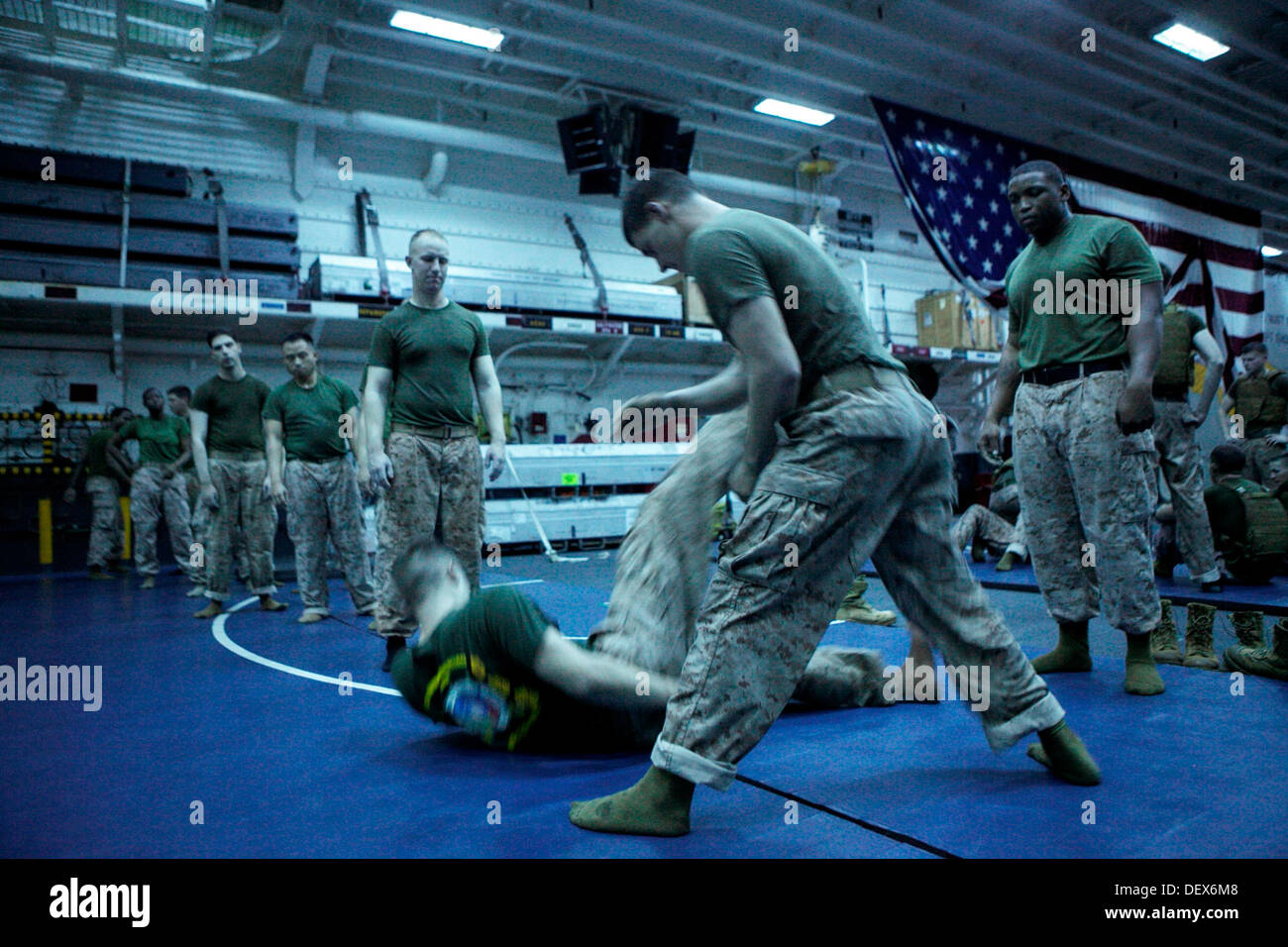 Marines and Sailors with the 31st Marine Expeditionary Unit conduct leg sweeps under the supervision of Sgt. Johnathon R. Robins - Stock Image
