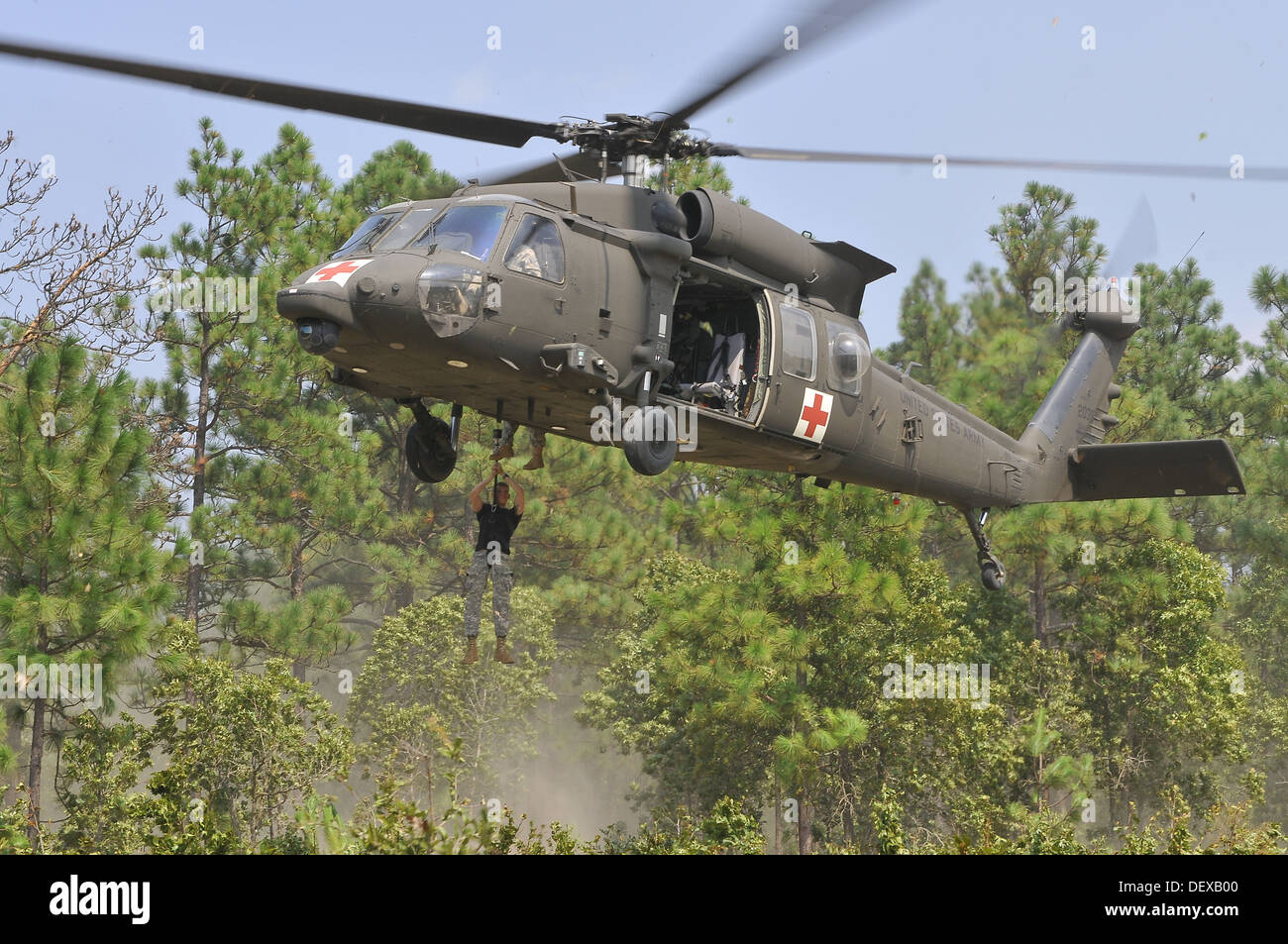Paratroopers of the 82nd Airborne Division's 2nd Brigade Combat Team and Combat Aviation Brigade evacuate a simulated casualty - Stock Image