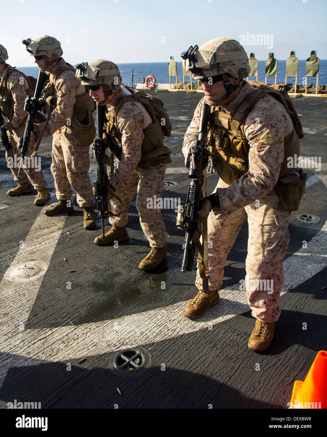 U.S. Marines assigned to Company L, Battalion landing Team 3/2, 26th Marine Expeditionary Unit (MEU), prepare to fire on targets during a live fire exercise on the flight deck of the USS San Antonio (LPD 17), at sea, Sept. 12, 2013. The 26th MEU is a Mari Stock Photo