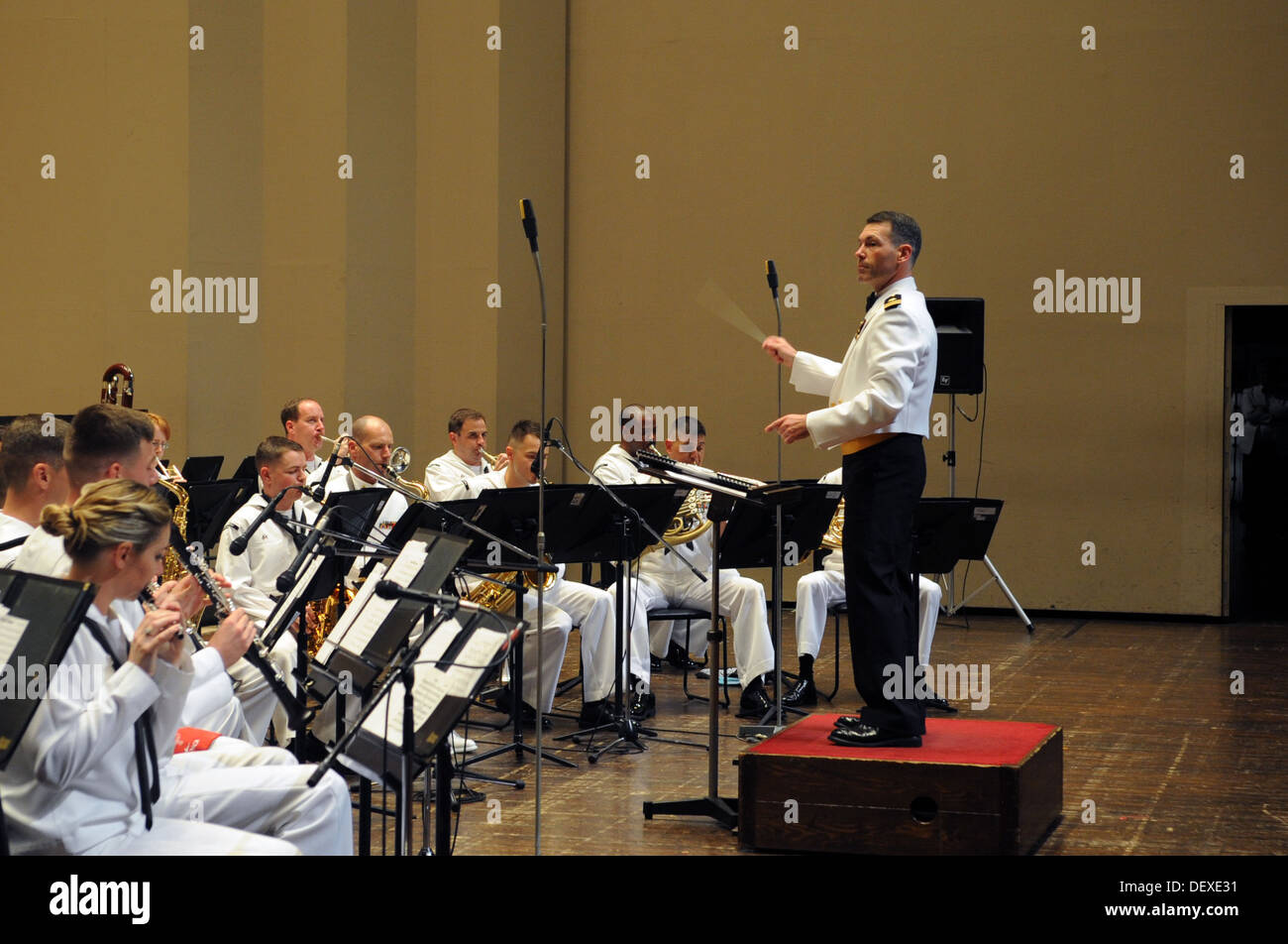 The U.S. 7th Fleet Band, conducted by Lt. Geordie Kelly, 7th Fleet bandmaster, performs at the Yokosuka Arts Theatre. Stock Photo
