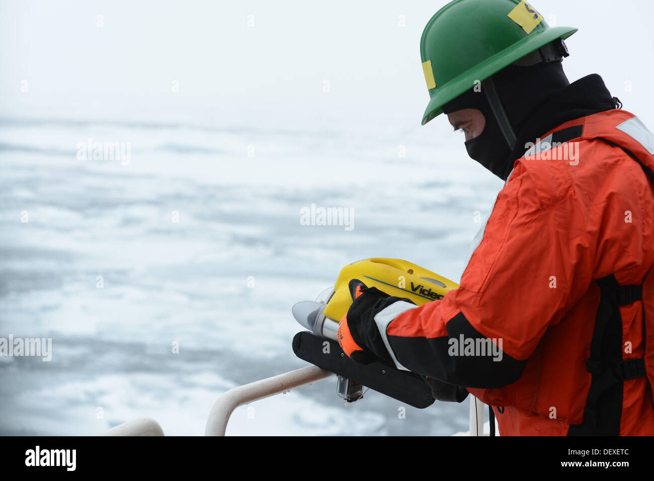 Jason Story, a project manager with the Coast Guard Research and Development Center, prepares to deploy a Coast Guard Marine Safety and Security Team remotely operated vehicle aboard the Coast Guard Cutter Healy during a simulated spilled oil response and - Stock Image