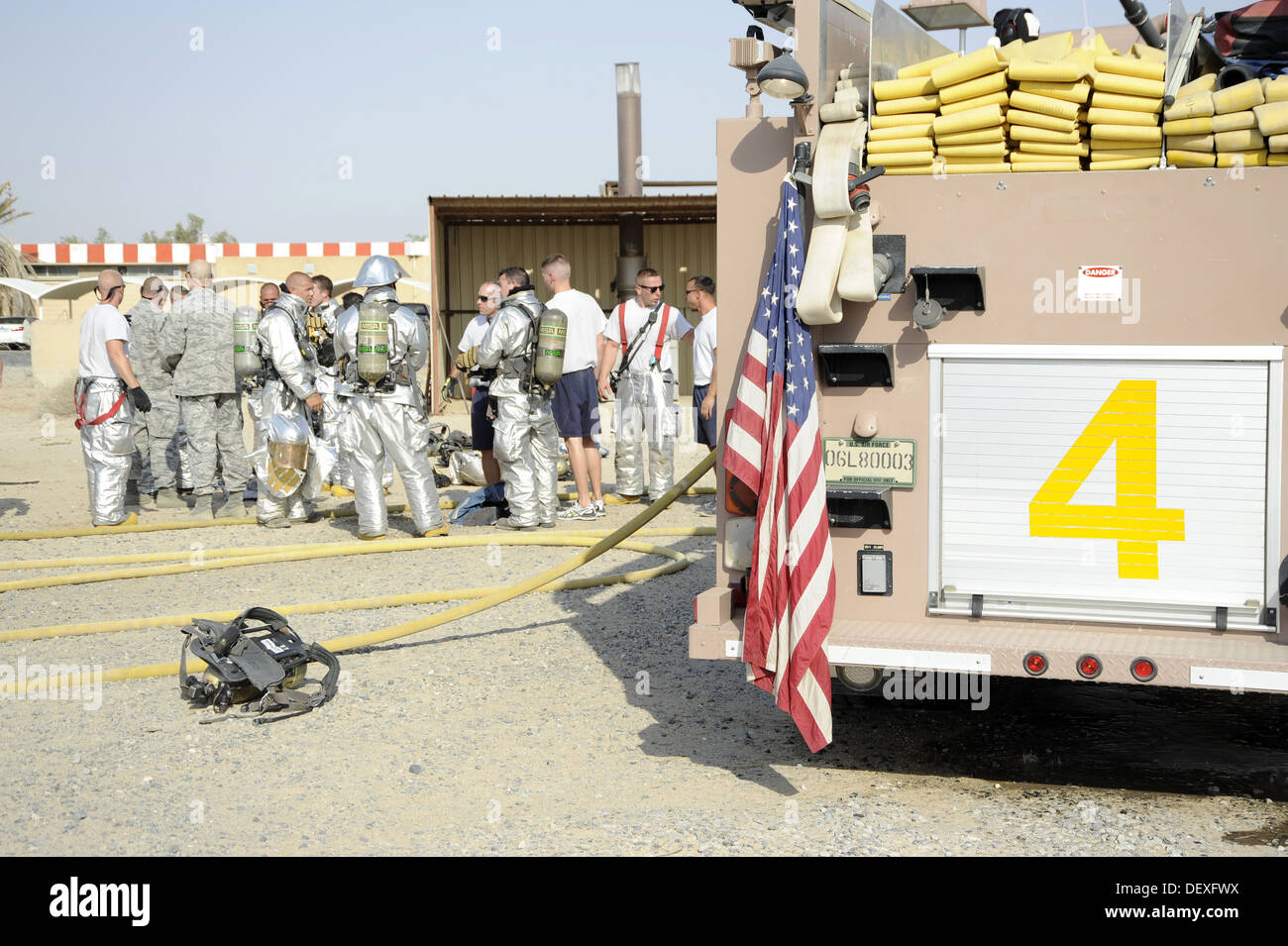 Members of the 386th Air Expeditionary Wing group together to discuss what took place in the shipping container here, Sept. 16, - Stock Image
