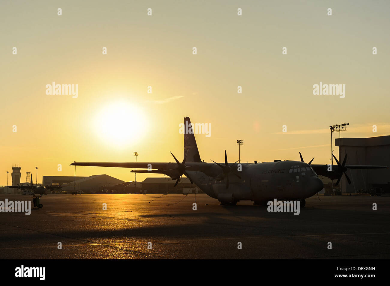 A C-130J waits for a flight crew to begin preflight inspections before takeoff Sept. 17, 2013, at Little Rock Air Force Base, Ark. Little Rock is home to 25 percent of the total U.S. Air Force C-130 fleet. - Stock Image