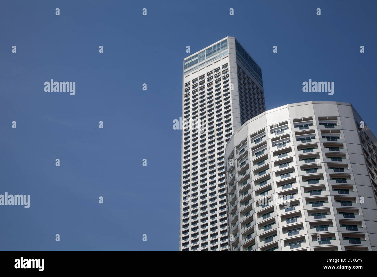 Skyscrapers Singapore sky two buildings Asia blue power modern architecture contemporary gray bold financial offices tower hotel - Stock Image