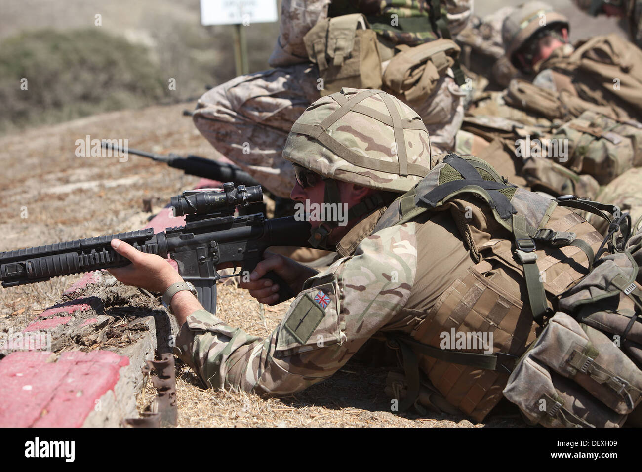 British Army Commandos with 148th Battery, 29th Commando Fire Support Team, Royal Artillery, hold security during Exercise Burmese Chase 2013, a bilateral training exercise between U.S. and British military forces aboard Camp Pendleton, Calif., Sept. 10. - Stock Image