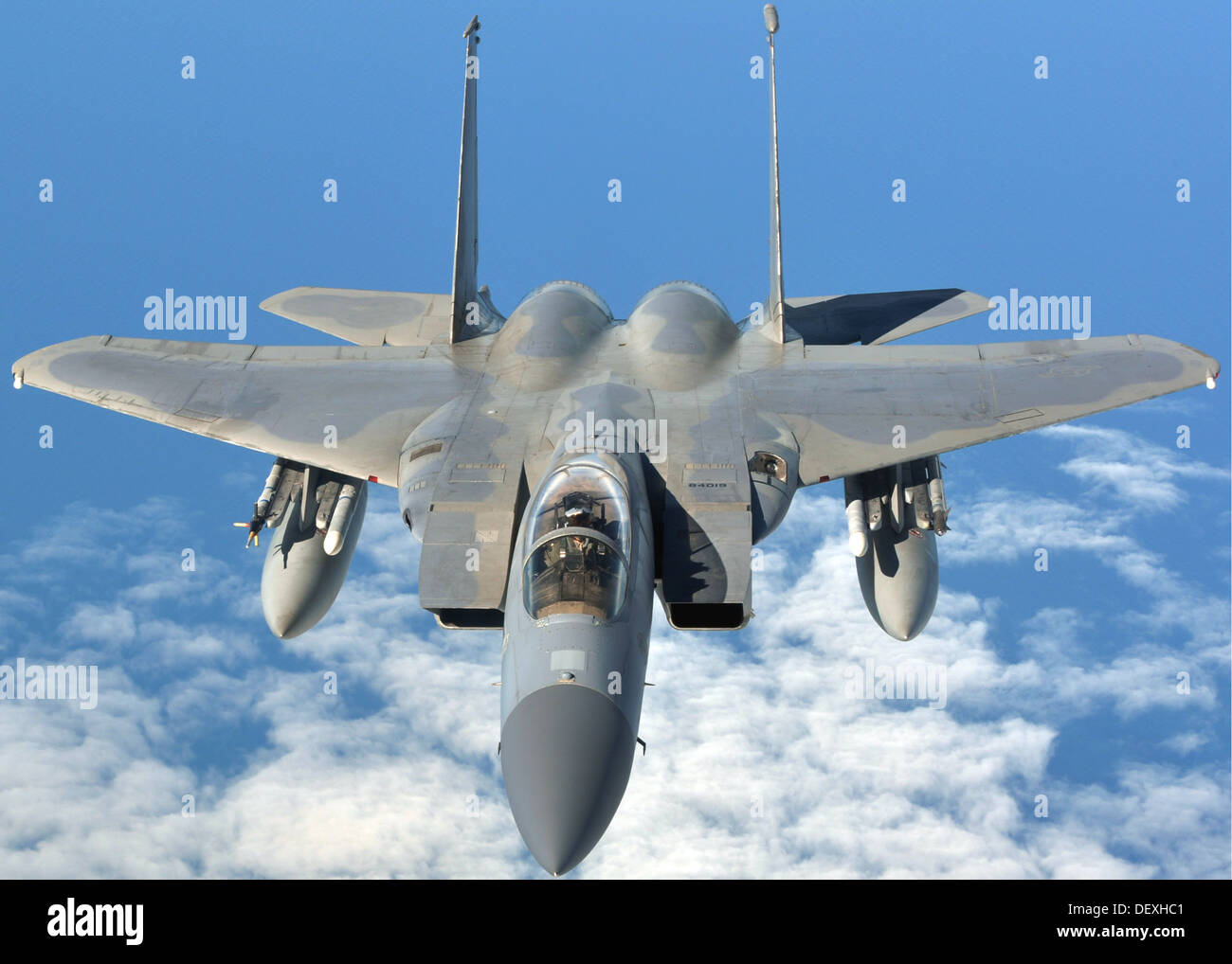 An U.S. Air Force F-15C Eagle prepares to refuel with a U.S. Air Force KC-135R Stratotanker Sept. 12, 2013, en route Stock Photo