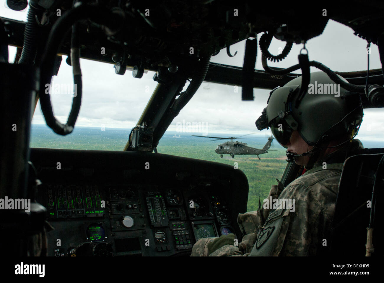 Chief Warrant Officer 2 Eric Willett, controls the UH-60 Blackhawk during a multi-ship training mission, Saturday Sept. 16. Willett, and soldiers from the Maine Army National Guard's 3rd Battalion, 142nd Aviation regiment rehearsed take-offs, flying, and - Stock Image