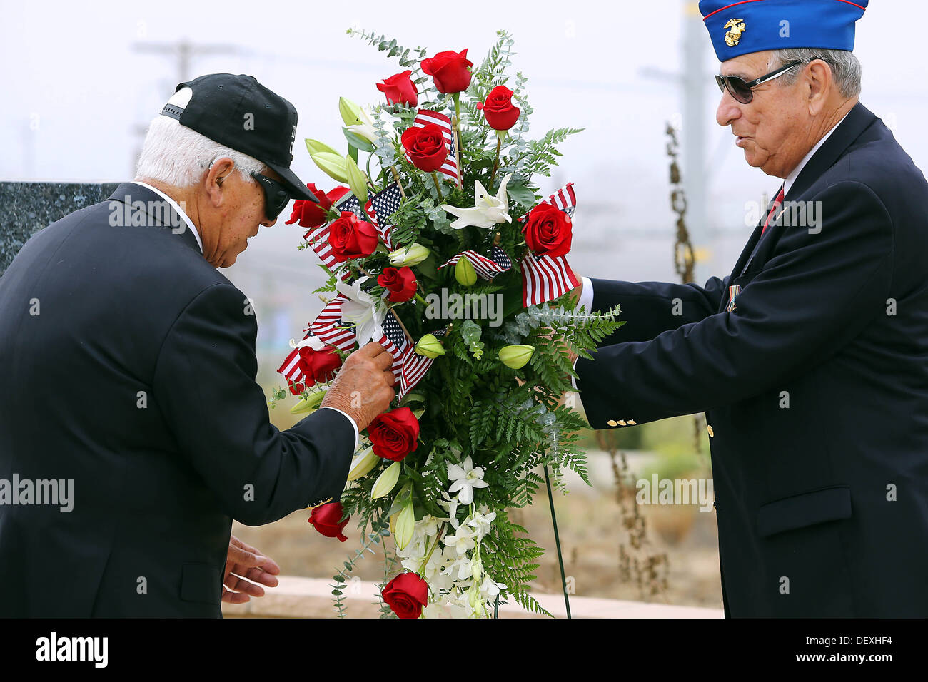 The Past National President of the Chosin Few Chapter Bob Licker holds the wreath for the Chosen Few veterans that are placing American flags in it during the 63rd Anniversary of the Landing on Inchon held at the Chosin Few Monument adjacent to the Pacifi - Stock Image