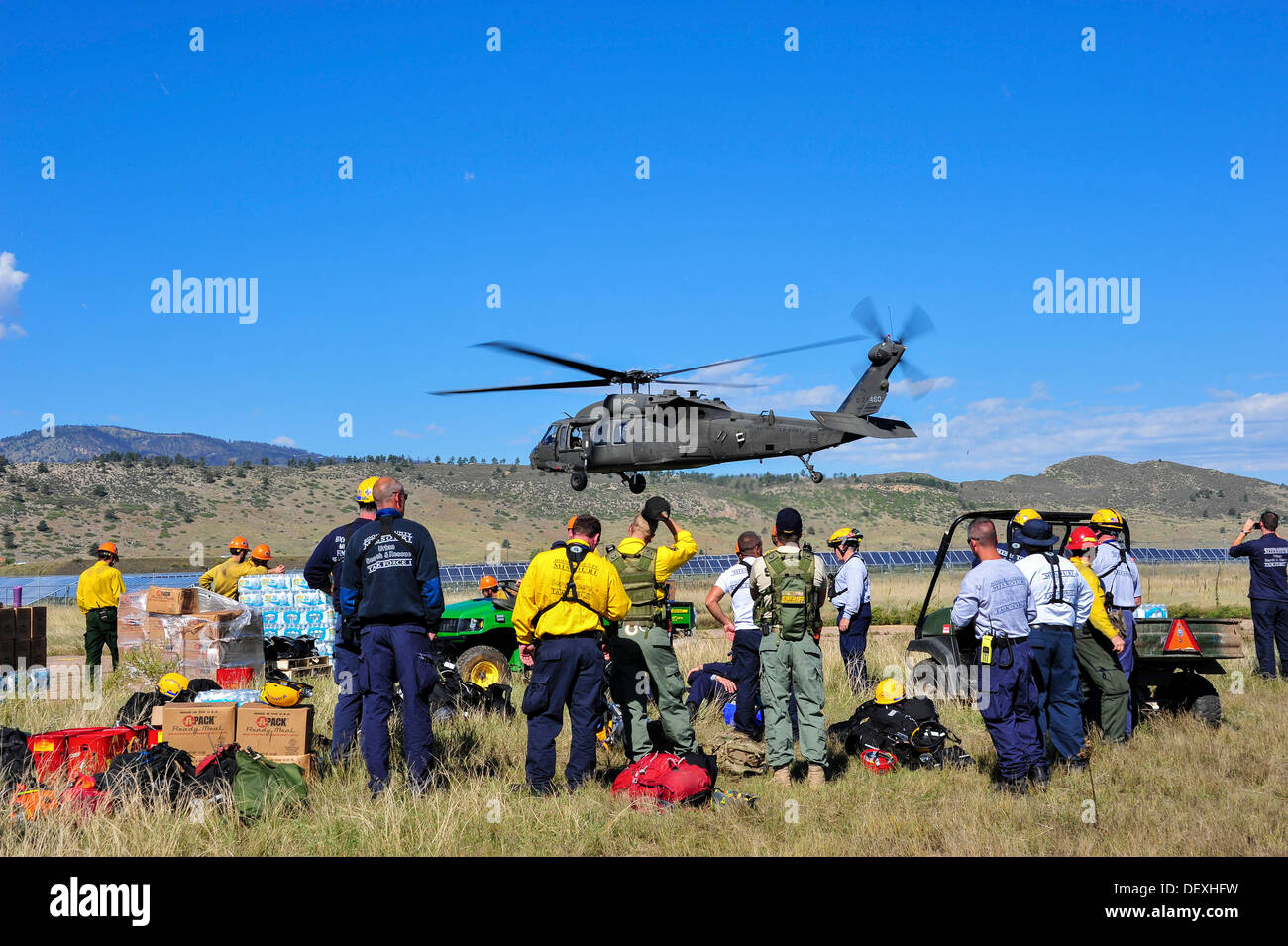 With much needed clear skies in the forecast, Colorado and national civil search and rescue teams from around the country watch - Stock Image
