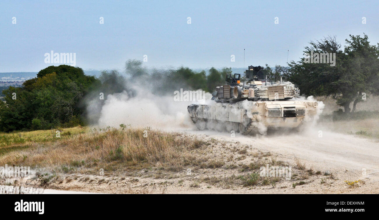 A U.S. Army M1A2 Abrams tank assigned to Delta Company, 1st Battalion, 12th Cavalry Regiment, 3rd Brigade Combat Stock Photo