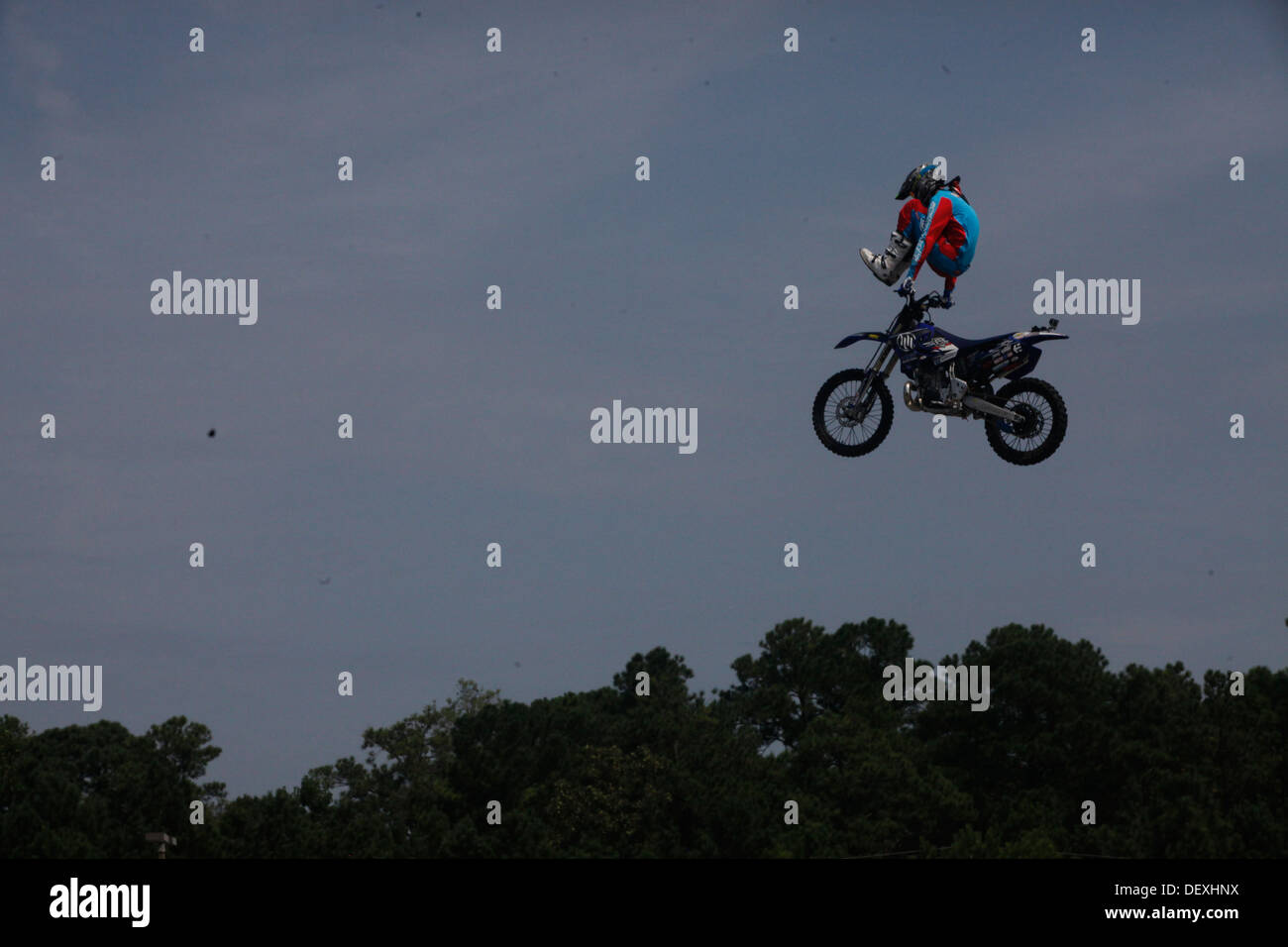 Jeff Griffin, freestyle motocross rider, performs a sterilizer trick for fans during an event hosted at the Marine Corps Exchange aboard Marine Corps Base Camp Lejeune, Sept. 13. More than 500 spectators gathered for the motocross event. - Stock Image