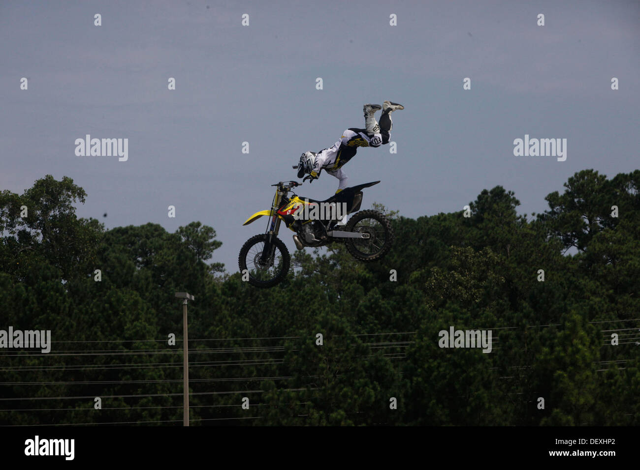 Dustin Miller, freestyle motocross rider, performs a superman seat grab trick for service members and families during an event held at the Marine Corps Exchange aboard Marine Corps Base Camp Lejeune, Sept. 13. - Stock Image