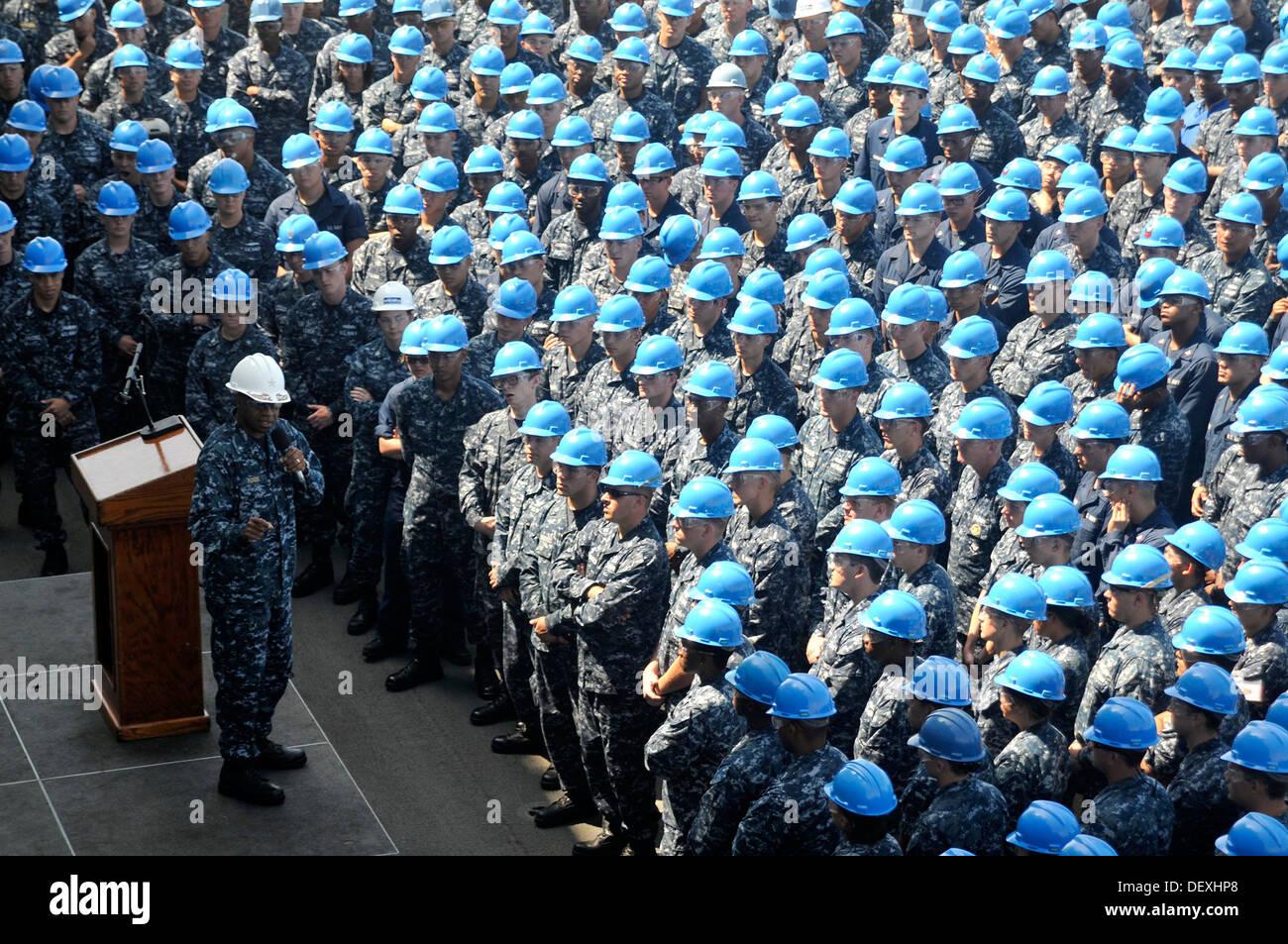 Commander, Expeditionary Strike Group 3 Rear Adm. Frank L. Ponds addresses the crew of amphibious assault ship USS Stock Photo
