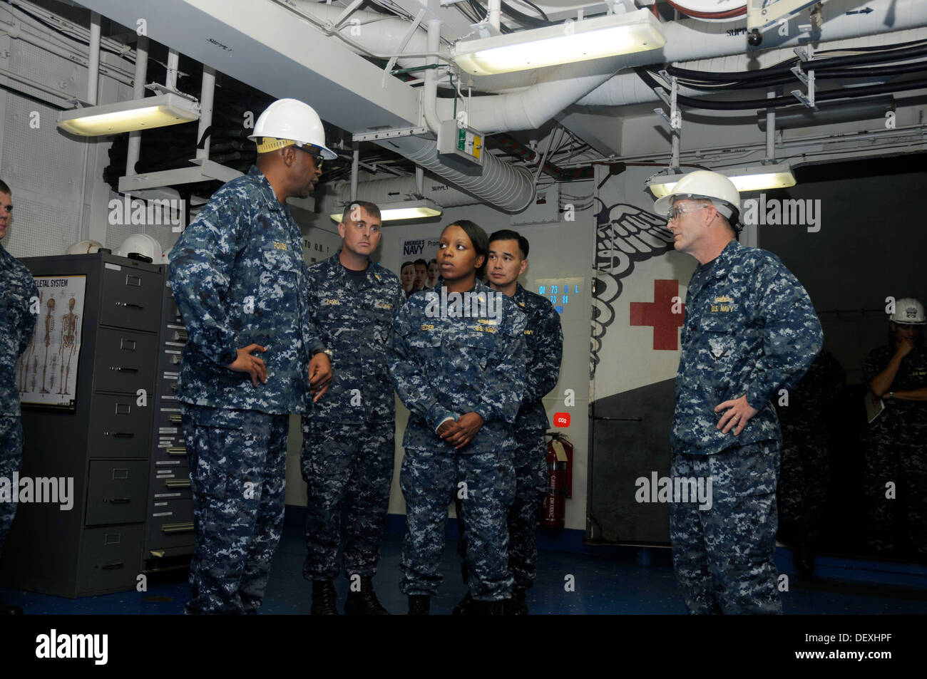 Commander, Expeditionary Strike Group 3 Rear Adm. Frank L. Ponds tours main medical during his visit to amphibious Stock Photo