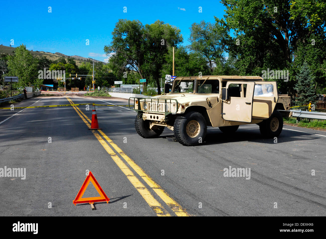 U.S. Soldiers and airmen from the Colorado National Guard set up a checkpoint at the bridge crossing over the St. Vrain River into Lyons, Colo., were flooding destroyed homes and businesses making it an unsafe area to go, Sept. 16, 2013. According to the - Stock Image