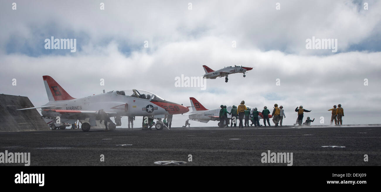 A T-45C Goshawk from Training Wing (TW) 1 taxies to the bow catapults on the flight deck of the aircraft carrier USS Carl Vinson (CVN 70). Carl Vinson is underway conducting unit-level training off the coast of Southern California. - Stock Image