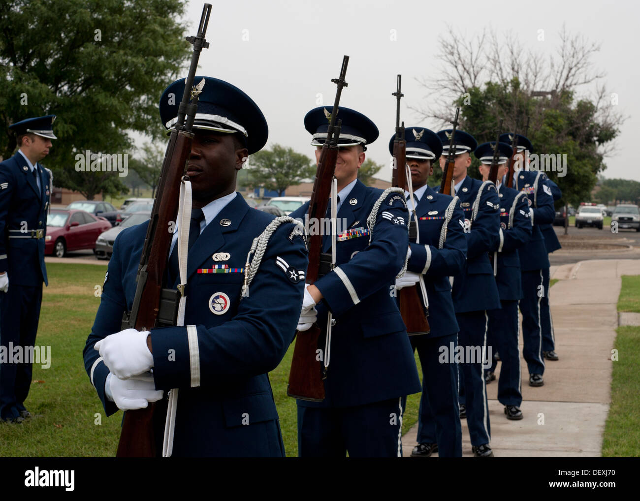 Airmen from the 22nd Air Refueling Wing Honor Guard prepare to render a 21-gun salute Sept. 16, 2013, at McConnell Air Force Base, Kan. This ceremony is practiced until it can be flawlessly performed. - Stock Image