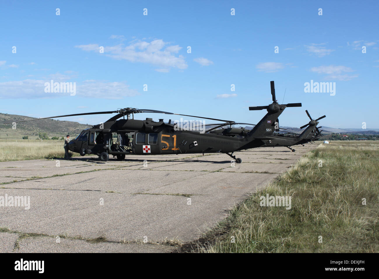 Marked and ready UH-60 Black Hawk helicopters from the Wyoming Army National Guard's C Company, 5-159th General Aviation Support Regiment, also known as Charlie-Med, stand ready to begin their mission supporting civil authorities in Larimer County, Colo., - Stock Image