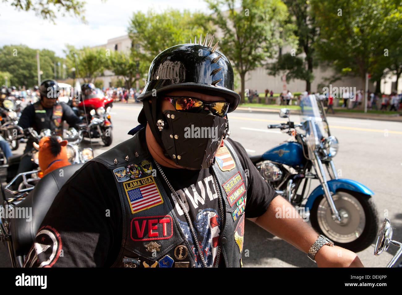 Harley Davidson motorcycle rider wearing leather mask - Stock Image
