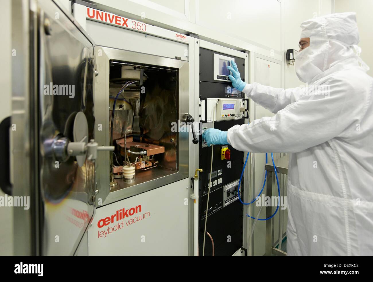 Layer deposition by using e-beam evaporator, clean room, thermal and e-beam evaporator, CIC nanoGUNE, Nanoscience - Stock Image