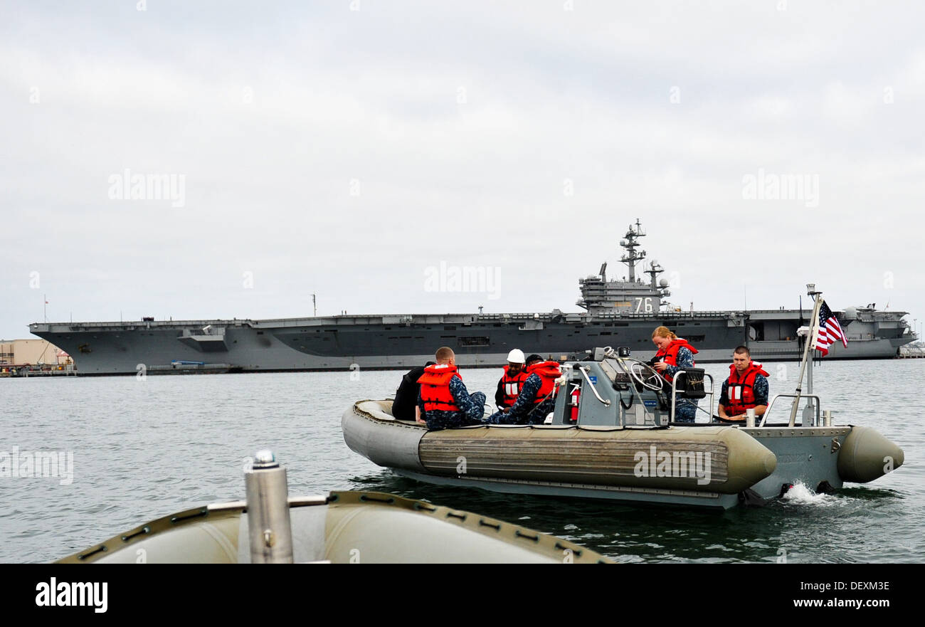 Sailors assigned to the aircraft carrier USS Ronald Reagan (CVN 76) operate a rigid-hull inflatable boat during an anti-terrorism training drill. Ronald Reagan is moored and homeported at Naval Base Coronado. - Stock Image