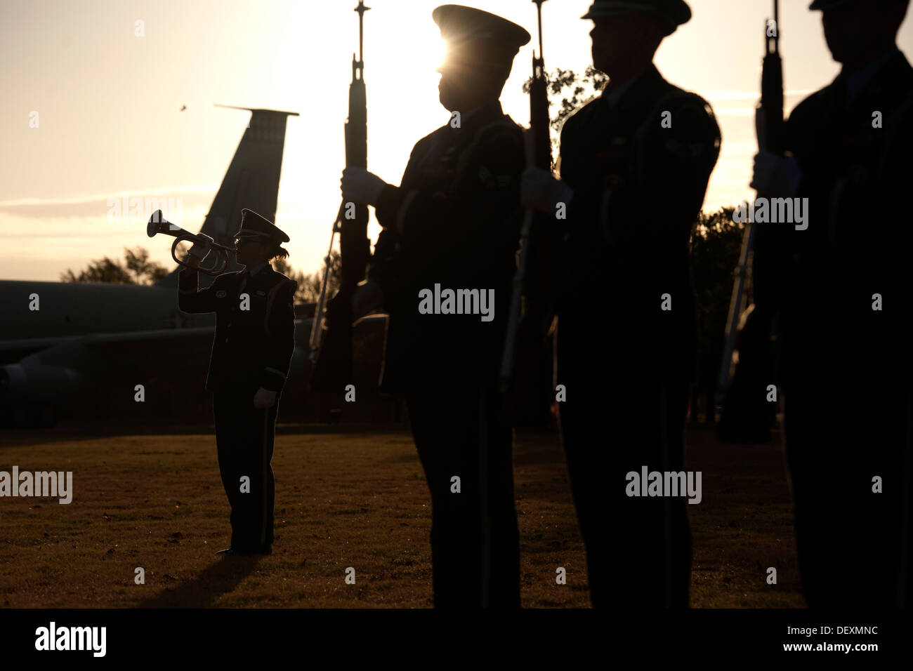 Altus AFB Honor Guard members perform a twenty-one gun salute and a bugle playing of taps during the third annual Prisoners of War and Missing in Action Remembrance Ceremony at the Wings of Freedom Park Sept. 19. This was among several events in remembran - Stock Image