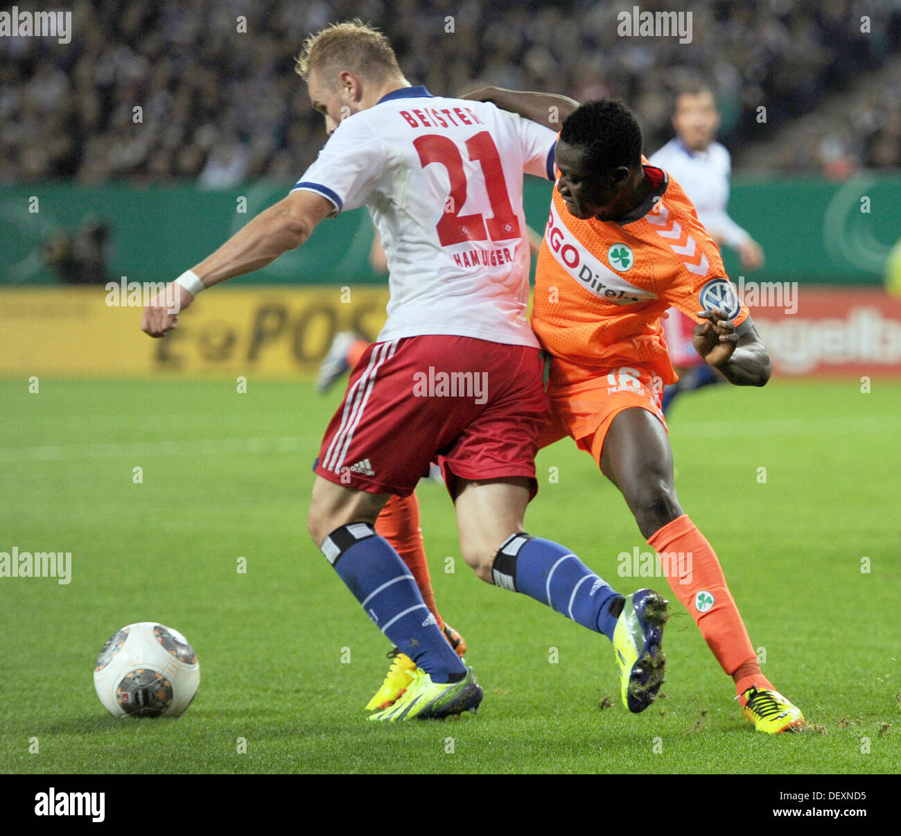 Hamburg, Germany. 24th Sep, 2013. Hamburg's Maximilian Beister (L) vies for the ball with Fuerth's Abdul Rahman Baba during the DFB Cup second round match between Hamburger SV and SpVgg Greuther Fuerth at Imtech Arena in Hamburg, Germany, 24 September 2013. Photo: ANGELIKA WARMUTH/dpa/Alamy Live News - Stock Image